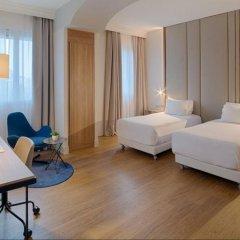 Отель NH Bologna De La Gare Италия, Болонья - 2 отзыва об отеле, цены и фото номеров - забронировать отель NH Bologna De La Gare онлайн комната для гостей фото 2