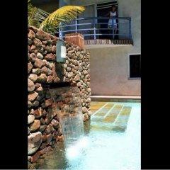 Отель Residence Les Cocotiers Французская Полинезия, Папеэте - отзывы, цены и фото номеров - забронировать отель Residence Les Cocotiers онлайн балкон