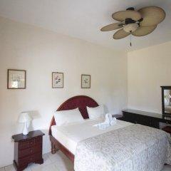 Отель Chateau Margarite Hotel Ямайка, Монтего-Бей - отзывы, цены и фото номеров - забронировать отель Chateau Margarite Hotel онлайн комната для гостей