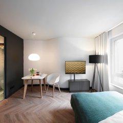 Отель Smartments Business MÜnchen Parkstadt Schwabing Мюнхен комната для гостей фото 3