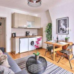 """Апартаменты Family Apartment """"buttes Chaumont"""" Париж комната для гостей"""