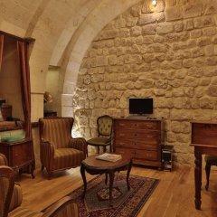 Отель Golden Cave Suites комната для гостей