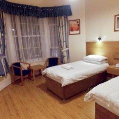 Отель The Victorian House сейф в номере