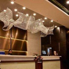 Отель Overseas Capital Hotel Китай, Джиангме - отзывы, цены и фото номеров - забронировать отель Overseas Capital Hotel онлайн интерьер отеля фото 3
