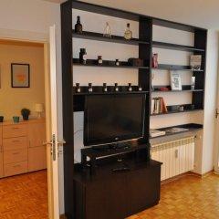 Отель Blue Books Apartments Польша, Варшава - отзывы, цены и фото номеров - забронировать отель Blue Books Apartments онлайн удобства в номере фото 2