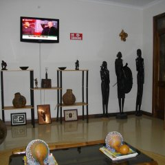 Апартаменты Calabash Green Executive Apartments Тема спортивное сооружение