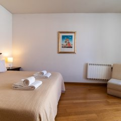 Апартаменты Chiado Apartments Лиссабон комната для гостей фото 4