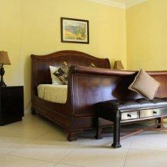Отель Milbrooks Resort Ямайка, Монтего-Бей - отзывы, цены и фото номеров - забронировать отель Milbrooks Resort онлайн сейф в номере