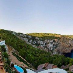 Отель Hacienda Na Xamena, Ibiza Испания, Пуэрто-Сан-Мигель - отзывы, цены и фото номеров - забронировать отель Hacienda Na Xamena, Ibiza онлайн балкон