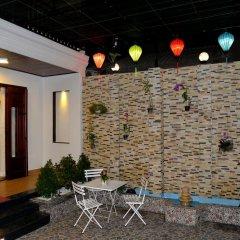 Отель Nuni Homestay Хойан бассейн