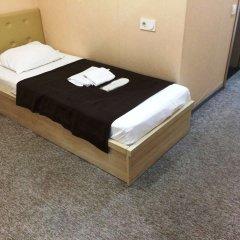 Отель Тбилисели Тбилиси сейф в номере