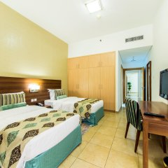 Nojoum Hotel Apartments комната для гостей