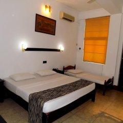 Отель Kandyan Arts Residency Канди сейф в номере