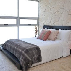 Отель Magia Beachside Condo Плая-дель-Кармен комната для гостей фото 5