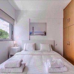 Отель Modern & Lovely Athenian Riviera Apartment with FREE PARKING! Греция, Афины - отзывы, цены и фото номеров - забронировать отель Modern & Lovely Athenian Riviera Apartment with FREE PARKING! онлайн комната для гостей фото 3