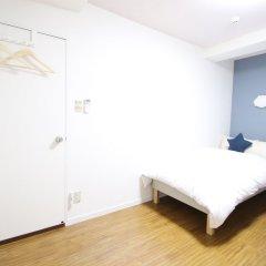 Отель AMP FLAT Nishijin5 Фукуока сейф в номере