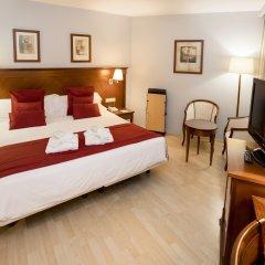 Отель Golden Tulip Andorra Fènix комната для гостей