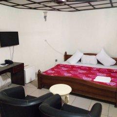 Отель Bv.Standard Executive Suite Нигерия, Калабар - отзывы, цены и фото номеров - забронировать отель Bv.Standard Executive Suite онлайн комната для гостей фото 4