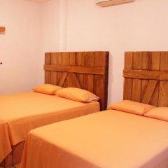 Отель BM Zihua Casa de Huéspedes комната для гостей фото 3