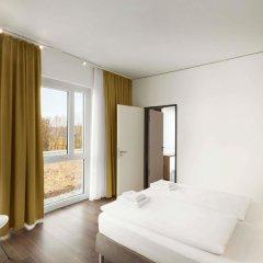 Отель Super 8 Munich City North Мюнхен комната для гостей фото 2