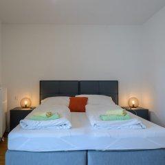 Апартаменты FeelGood Apartments Seestadt Green Living Вена сейф в номере