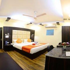 Отель Fabhotel Kailash Colony Metro Station комната для гостей