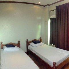 Отель MC Mountain Home Apartelle Филиппины, Тагайтай - отзывы, цены и фото номеров - забронировать отель MC Mountain Home Apartelle онлайн комната для гостей фото 2
