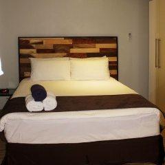 Апартаменты Greystone Apartments 01 сейф в номере