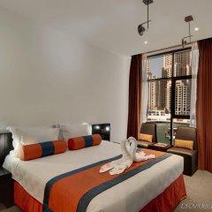 Signature Hotel Apartments & Spa комната для гостей