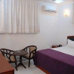 Отель Malik Continental Индия, Нью-Дели - отзывы, цены и фото номеров - забронировать отель Malik Continental онлайн комната для гостей фото 2