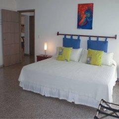 Отель Apartamento Turístico Edificio Calima Колумбия, Сан-Андрес - отзывы, цены и фото номеров - забронировать отель Apartamento Turístico Edificio Calima онлайн комната для гостей
