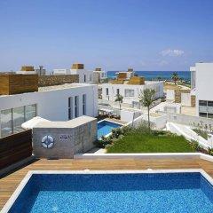 Отель Paradise Cove Luxurious Beach Villas Кипр, Пафос - отзывы, цены и фото номеров - забронировать отель Paradise Cove Luxurious Beach Villas онлайн балкон