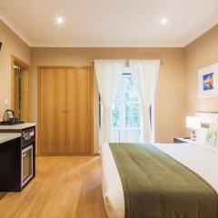 Отель Residencial Vila Nova Лиссабон удобства в номере