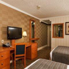 Отель The Glenmore Inn & Convention Centre Канада, Калгари - отзывы, цены и фото номеров - забронировать отель The Glenmore Inn & Convention Centre онлайн удобства в номере фото 2