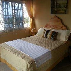 Отель A Piece of Paradise Montego Bay Ямайка, Монтего-Бей - отзывы, цены и фото номеров - забронировать отель A Piece of Paradise Montego Bay онлайн комната для гостей