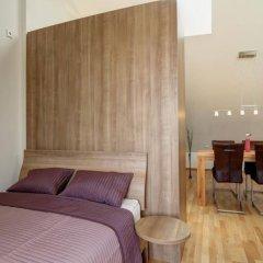 Апартаменты Paleo Finest Serviced Apartments Мюнхен комната для гостей фото 5