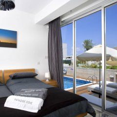 Отель Paradise Cove Luxurious Beach Villas Кипр, Пафос - отзывы, цены и фото номеров - забронировать отель Paradise Cove Luxurious Beach Villas онлайн комната для гостей