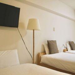 Отель Hukuhuku Guesthouse Хаката сейф в номере