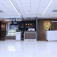 Отель Sleep Box By Miracle Бангкок интерьер отеля