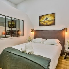Отель 05 - Designed Parisian Flat комната для гостей