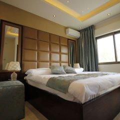 Отель Aqarco Shmaisani Apartment Иордания, Амман - отзывы, цены и фото номеров - забронировать отель Aqarco Shmaisani Apartment онлайн комната для гостей фото 3