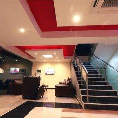 Отель Tivoli Garden Ikoyi Waterfront Нигерия, Лагос - отзывы, цены и фото номеров - забронировать отель Tivoli Garden Ikoyi Waterfront онлайн интерьер отеля