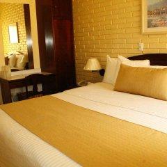 Отель Mac Arthur Гондурас, Тегусигальпа - отзывы, цены и фото номеров - забронировать отель Mac Arthur онлайн сейф в номере