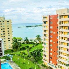 Отель Beach Sands Studio 210E - Turtle Tower Ямайка, Очо-Риос - отзывы, цены и фото номеров - забронировать отель Beach Sands Studio 210E - Turtle Tower онлайн балкон