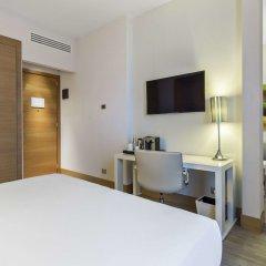 Отель NH Milano Touring удобства в номере