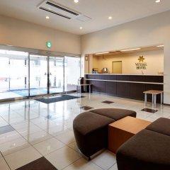 Отель Vessel Hotel Fukuoka Kaizuka Япония, Порт Хаката - отзывы, цены и фото номеров - забронировать отель Vessel Hotel Fukuoka Kaizuka онлайн интерьер отеля