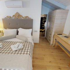 Отель Porto Enetiko Suites комната для гостей фото 4