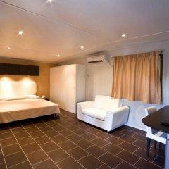 Отель Flaminio Village Bungalow Park комната для гостей фото 4