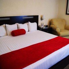 Отель Howard Johnson Plaza Las Torres Гвадалахара сейф в номере