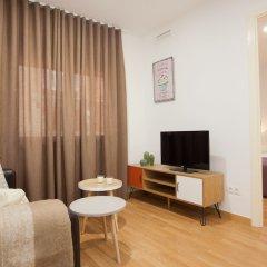 Апартаменты Click&Flat Europa Fira Apartments комната для гостей